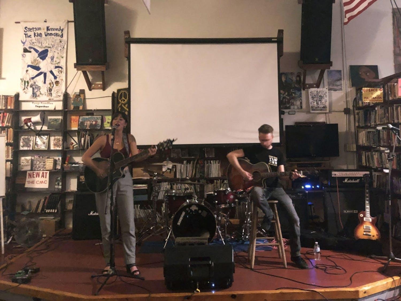 Charlene Joan (left) plays at the Civic Media Center on Sunday accompanied by guitarist Josh Gigantelli (right).
