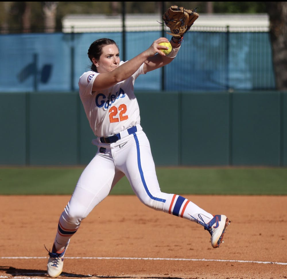 <p>Elizabeth Hightower winds up toward home plate March 3 against Florida State. The junior dominated Alabama in a series opening win Friday.</p>
