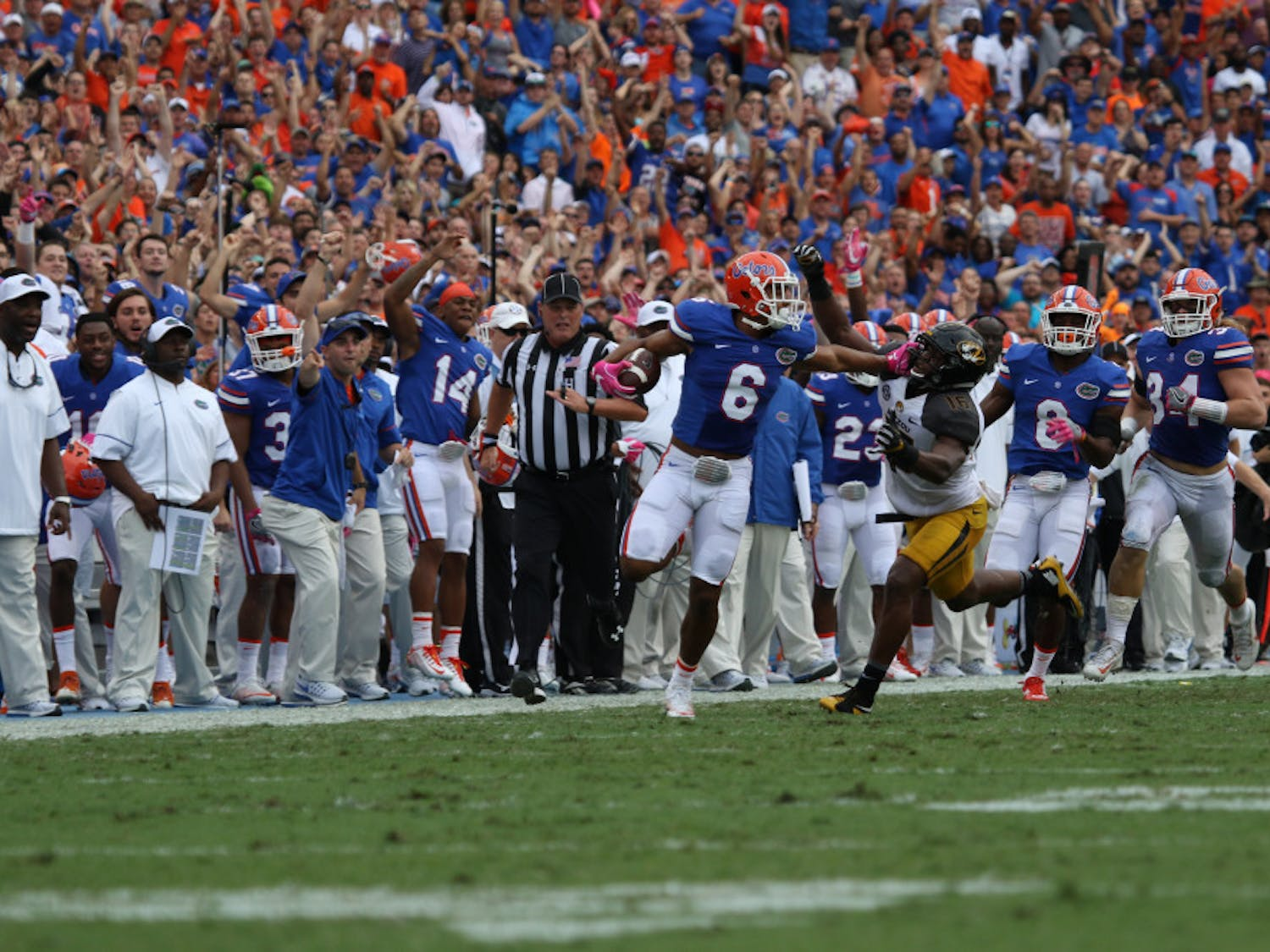 Quincy Wilson (6) stiff-arms a Missouri defender after intercepting a pass during Florida's 40-14 homecoming win over Missouri on Oct. 15, 2016, at Ben Hill Griffin Stadium.