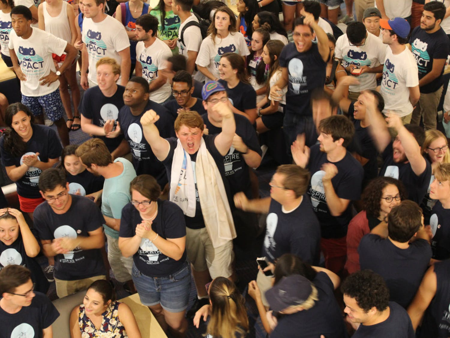 Inspire Party members cheer as Student Government election results are announced Wednesday night. Inspire won 20 seats, while Impact took 29.