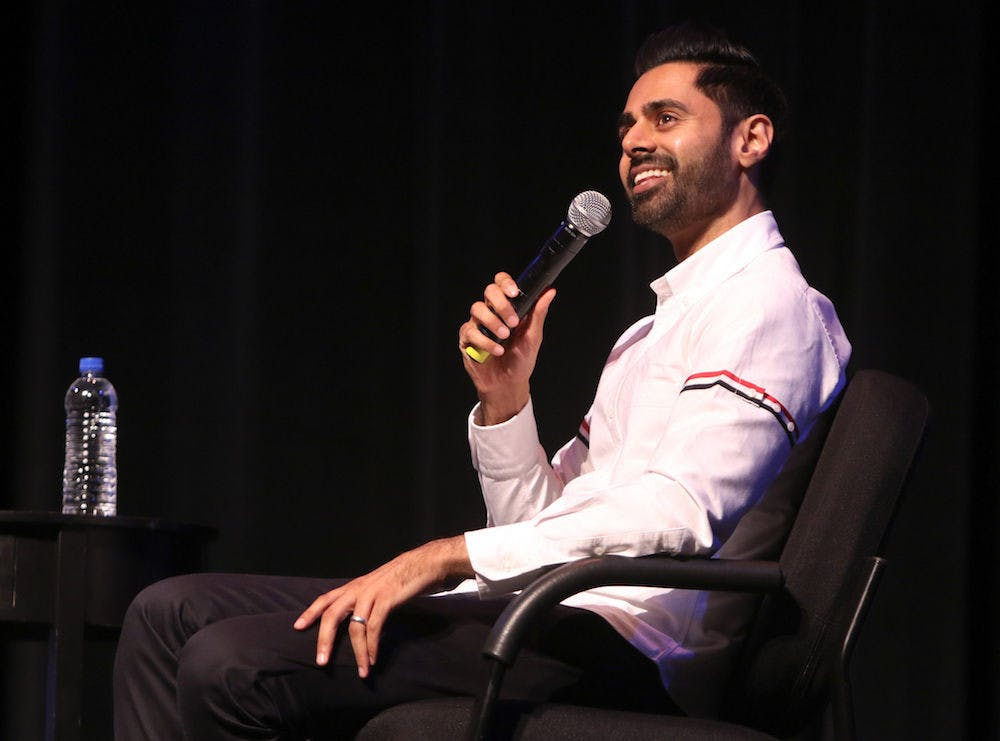 """<p dir=""""ltr""""><span>Hasan Minhaj, a 33-year-old comedian known for his time as a correspondent on """"The Daily Show"""" and his Netflix show """"Patriot Act with Hasan Minhaj,"""" answers questions Thursday at the &nbsp;Phillips Center for the Performing Arts. Around 1,750 attendees watched Minhaj answer questions asked by UF School of Journalism and Communications professor Mike Foley.</span></p>"""