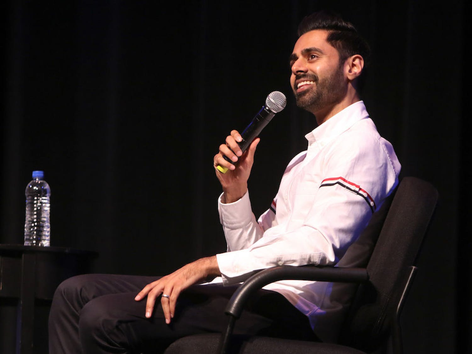"""Hasan Minhaj, a 33-year-old comedian known for his time as a correspondent on """"The Daily Show"""" and his Netflix show """"Patriot Act with Hasan Minhaj,"""" answers questions Thursday at the Phillips Center for the Performing Arts. Around 1,750 attendees watched Minhaj answer questions asked by UF School of Journalism and Communications professor Mike Foley."""