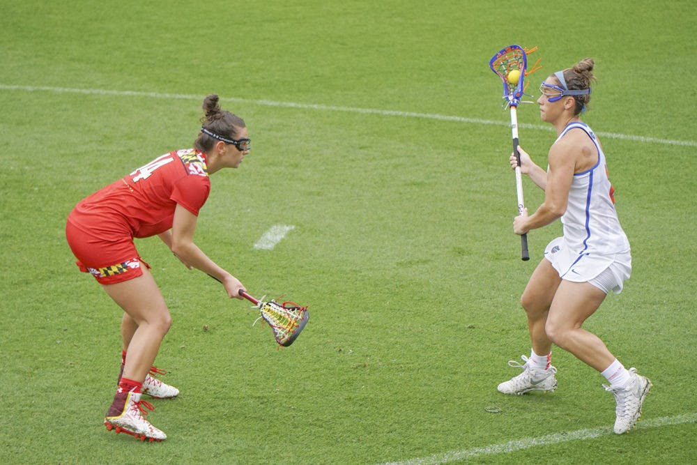 <p>Sammi Burgess makes a play on the ball during Florida's 14-4 loss on March 19, 2016 Maryland at Donald R. Dizney Stadium.&nbsp;</p>