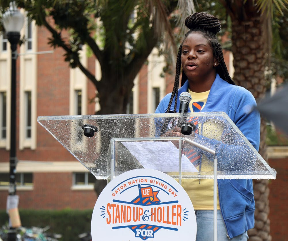 """<p dir=""""ltr""""><span>Akiya Parks, a first-generation student and Machen Florida Opportunity Scholar, addresses the crowd on the Plaza of the Americas Feb. 26, 2019, for the """"Stand Up and Holler: Gator Nation Giving Day.""""</span></p><p><span></span></p>"""