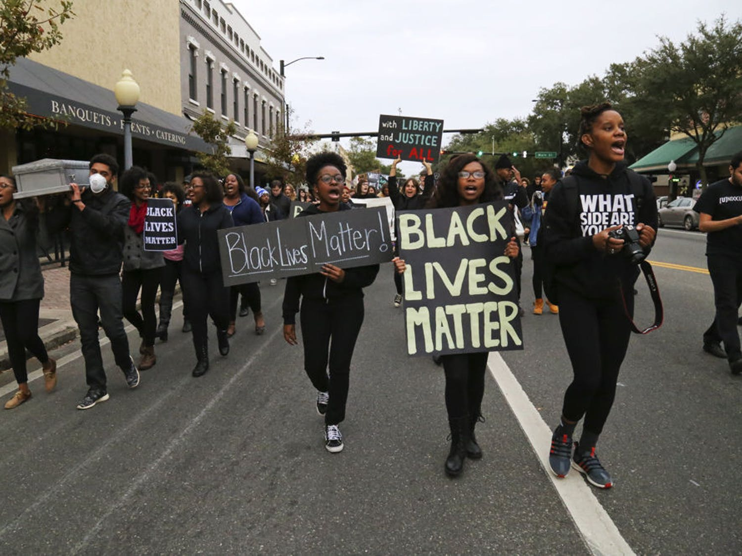 Protesters for the #BLACKLIVESMATTER march walk west on University Avenue on Monday afternoon.