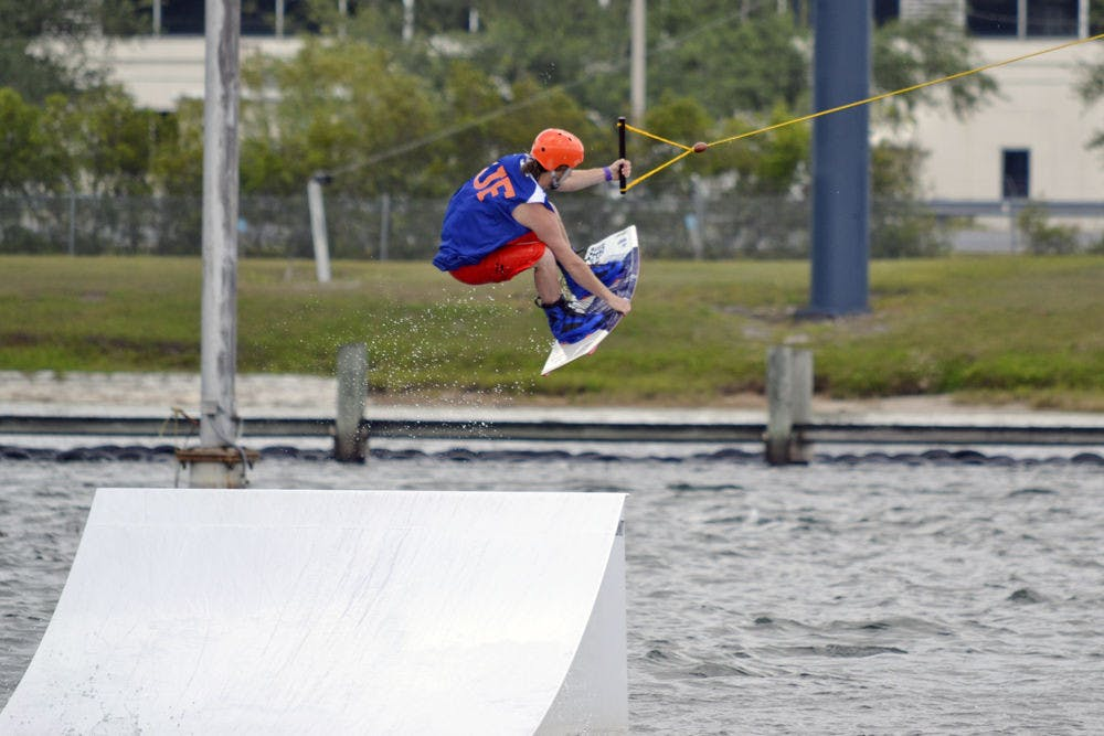 <p>Michael Hanna, a 22-year-old UF biochemistry senior, performs a wakeboard stunt on cables in the Orlando Watersports Complex on Sunday afternoon. UF's Wakeboarding Club placed second in the Red Bull Rival competition over the weekend.</p>