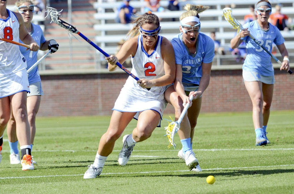 <p>Sophomore attacker Sammi Burgess fights for a ground ball during UF's 17-11 loss to UNC at Donald R. Dizney Stadium.</p>
