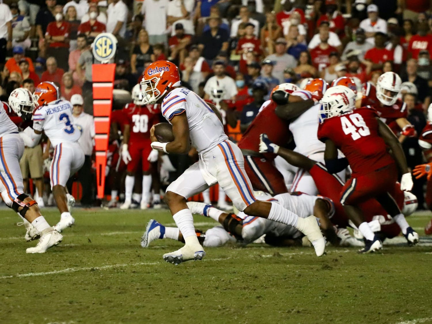 Quarterback Anthony Richardson scrambles against the FAU Owls. Richardson carried the ball seven times for 160 yards in the 35-14 win Saturday.
