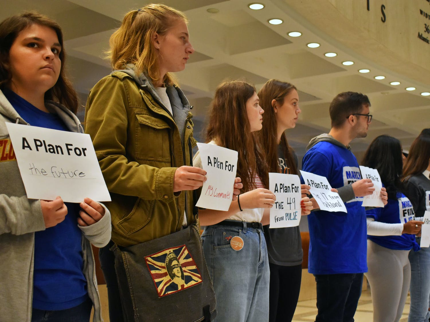 Students and activists demonstrated inside the Florida State Capitol building Thursday, holding filled-in signs representing what the Peace Plan for a Safer Florida means to them.