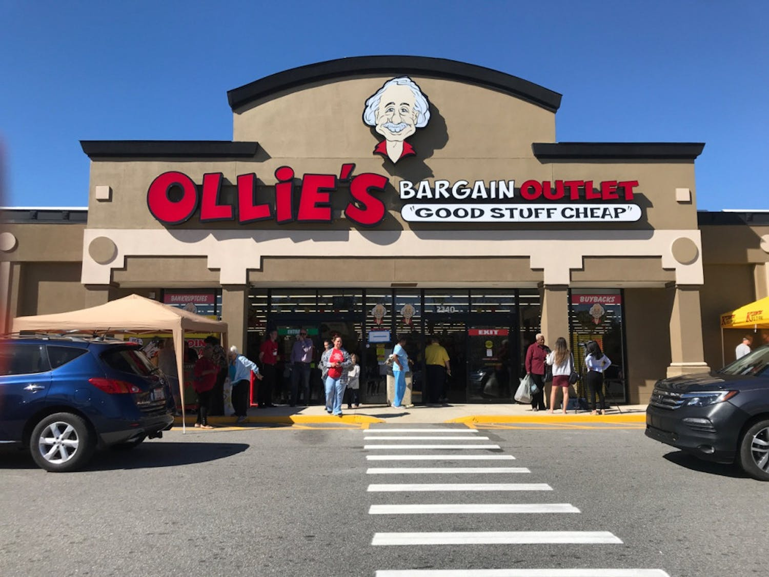 Customers walk in and out of Ollie's BargainOutlet,in Northside Shopping Center, located at2340 N Main St. The store opened Wednesday to hundreds of customers.