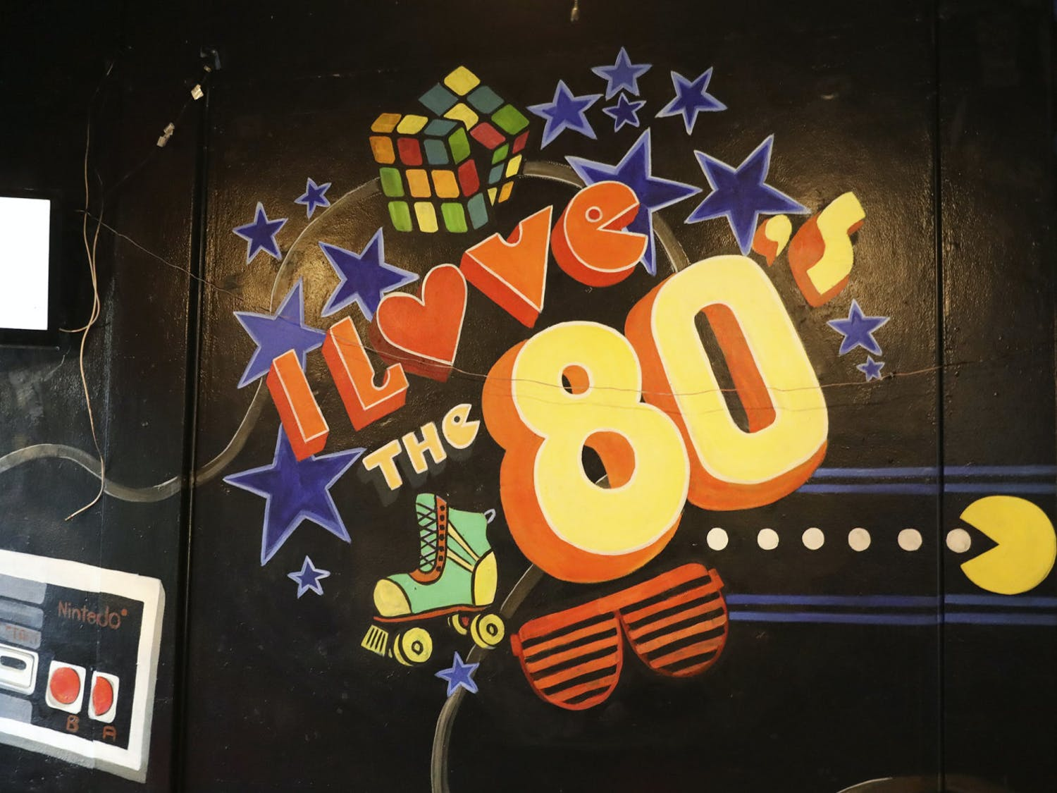 """A Pac-Man wall painting that reads """"I Love the 80s"""" sits on a wall of That 80s Bar Gainesville, located on West University Avenue on Friday, June 6, 2021."""