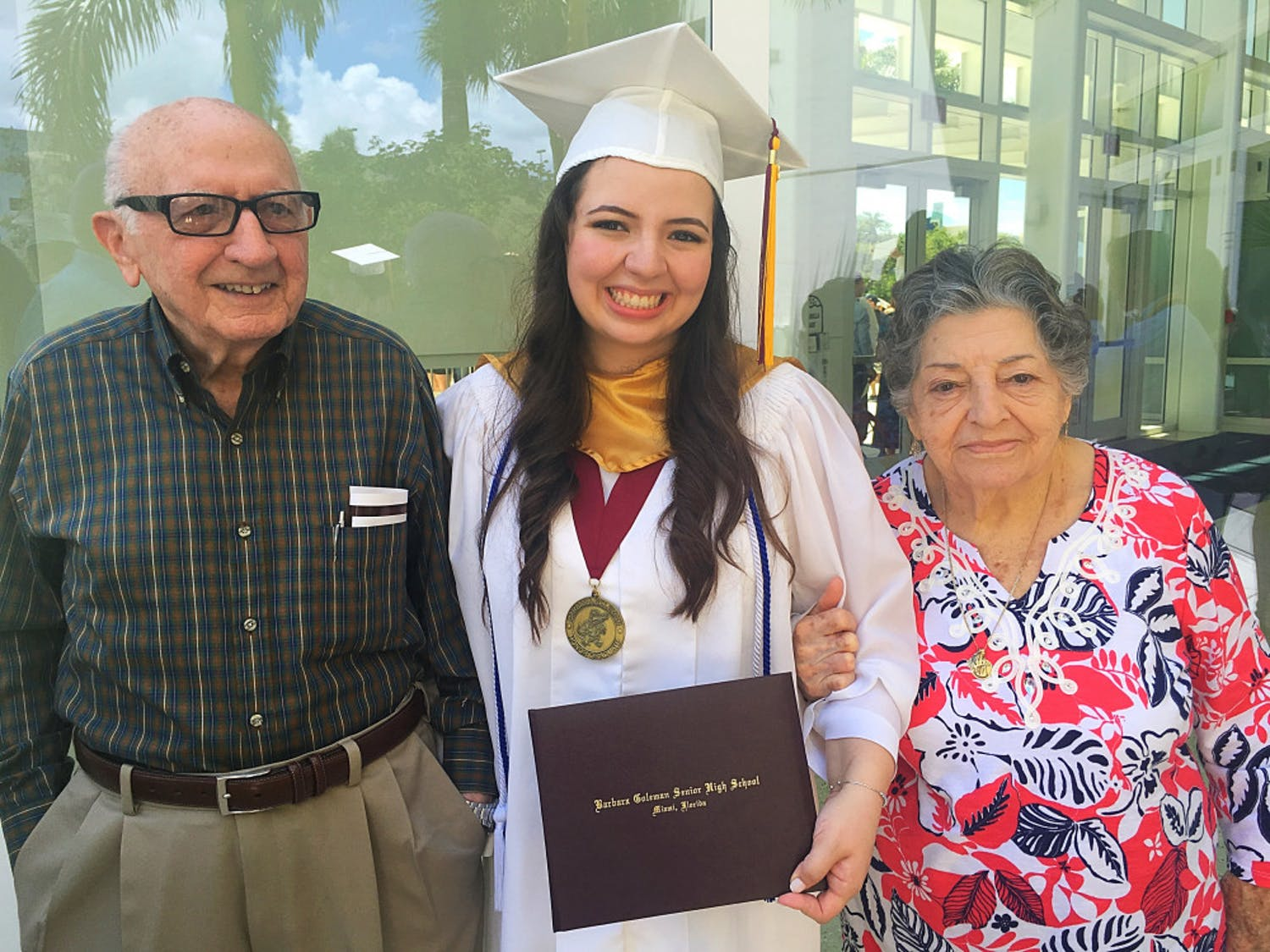 Christina Morales with Abuelo and Ayaya at her 2016 high school graduation from Barbara Goleman Senior High at Florida International University.
