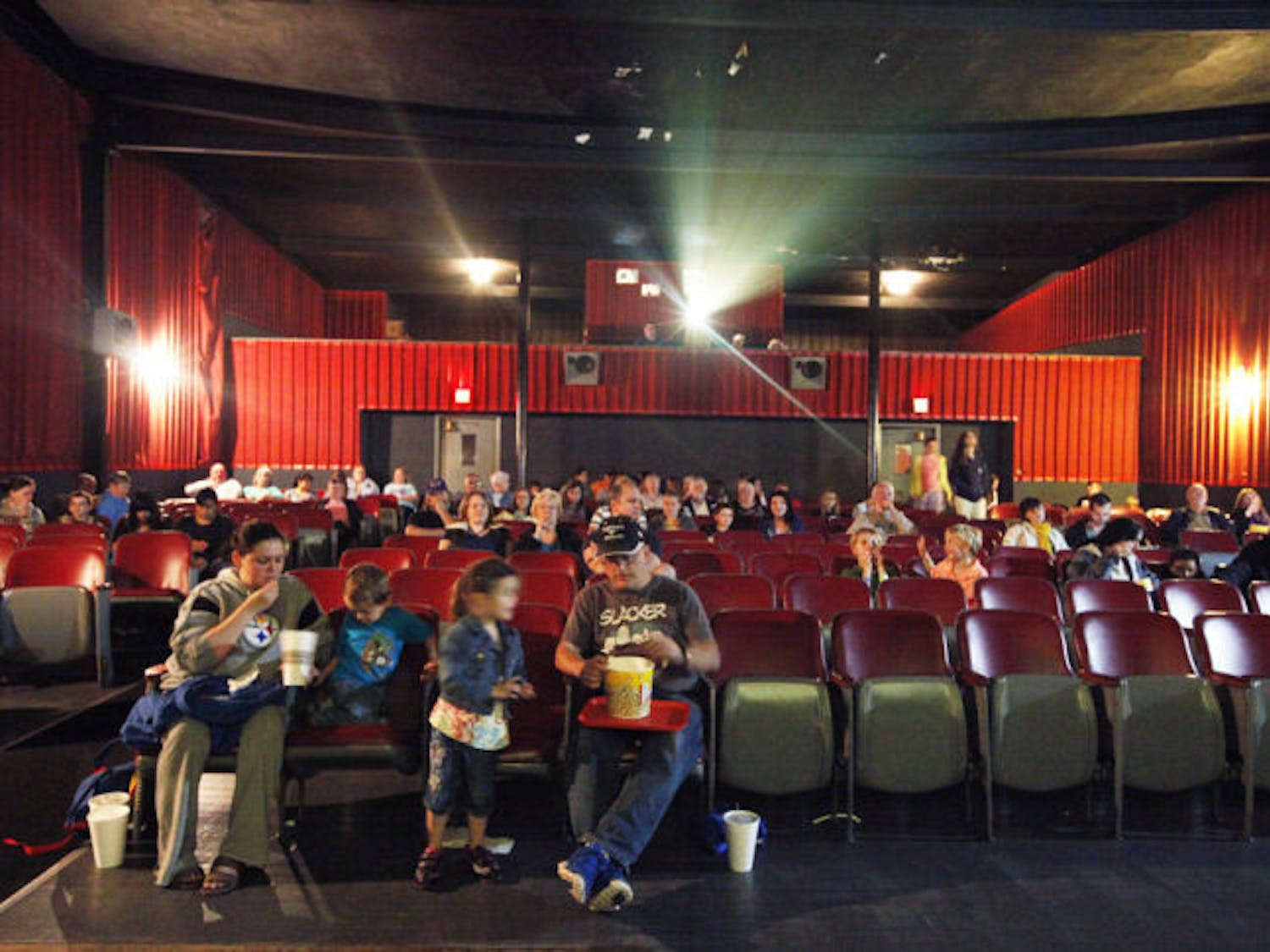"Movie-goers wait for the film ""The Croods"" to begin inside the Priest Theater in High Springs in 2013."