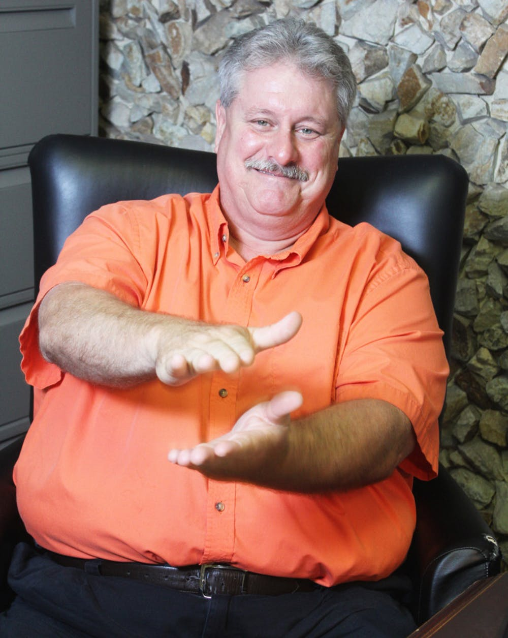 <p>John Martin does a Gator Chomp at his campaign headquarters Monday. Martin was part of the Hawthorne City Commission for 13 years.</p>