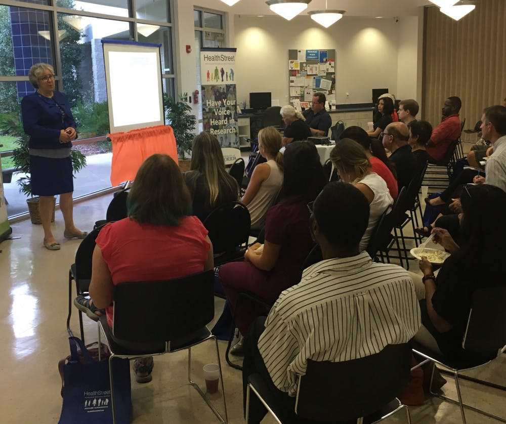<p><span>Catherine Striley, a co-director of HealthStreet, gives a PowerPoint presentation on the dangers of opioid drugs to about 25 Gainesville residents</span> <span><span>on Wednesday</span></span> <span>evening ahead of a panel discussion live-viewing, hosted by the UF Health Community Engagement Center.</span></p>