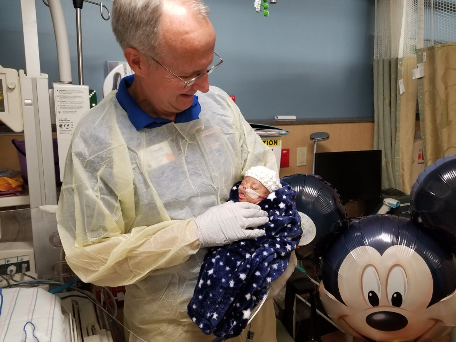 Cliff Preston, 63, was nominated for the NASCAR Foundation Betty Jane France Humanitarian Award for his volunteer work as a baby cuddler at UF Health Shands Hospital in the neonatal intensive care unit.