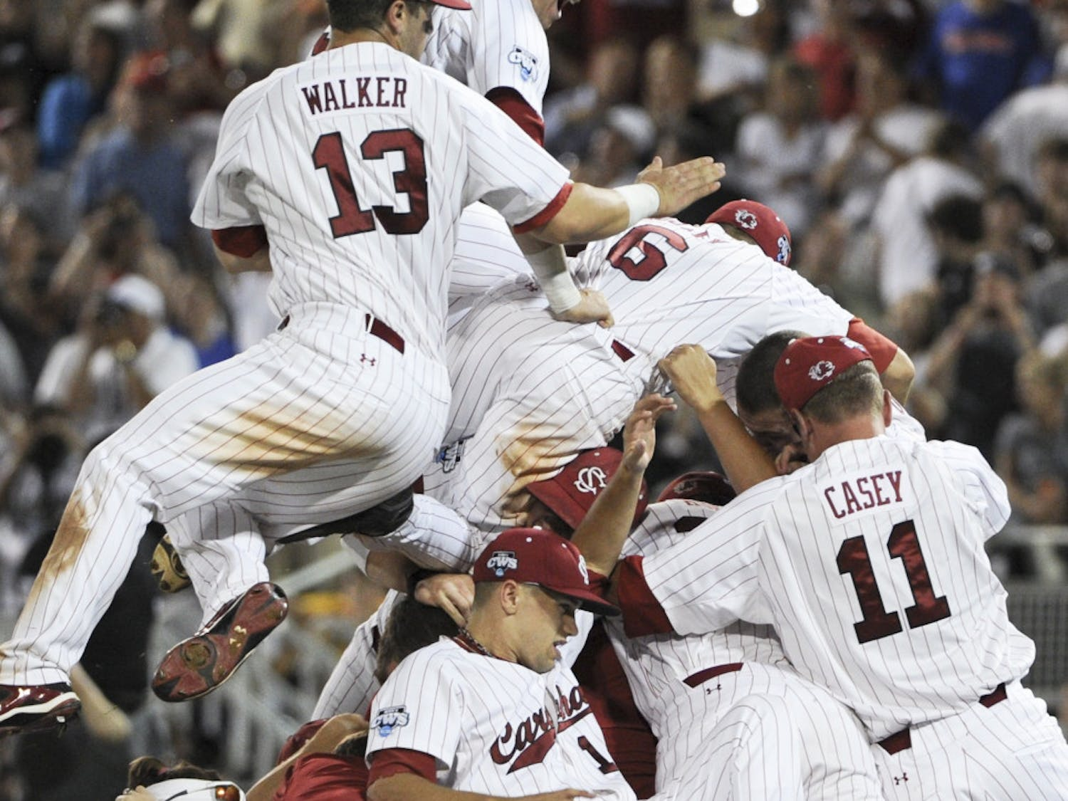 South Carolina players celebrate after beating Florida 5-2 in Game 2 of the NCAA baseball College World Series best-of-three finals.