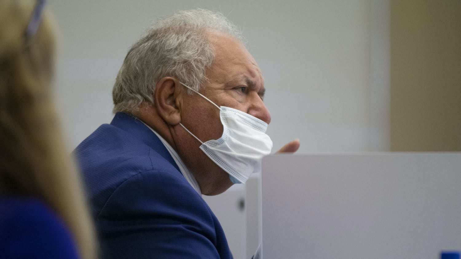 Chairman Mori Hosseini's mask slips down his face as he participates in the discussion after public comment. Later in the meeting, Hosseini removed his mask and talked at length while the board approved action items.
