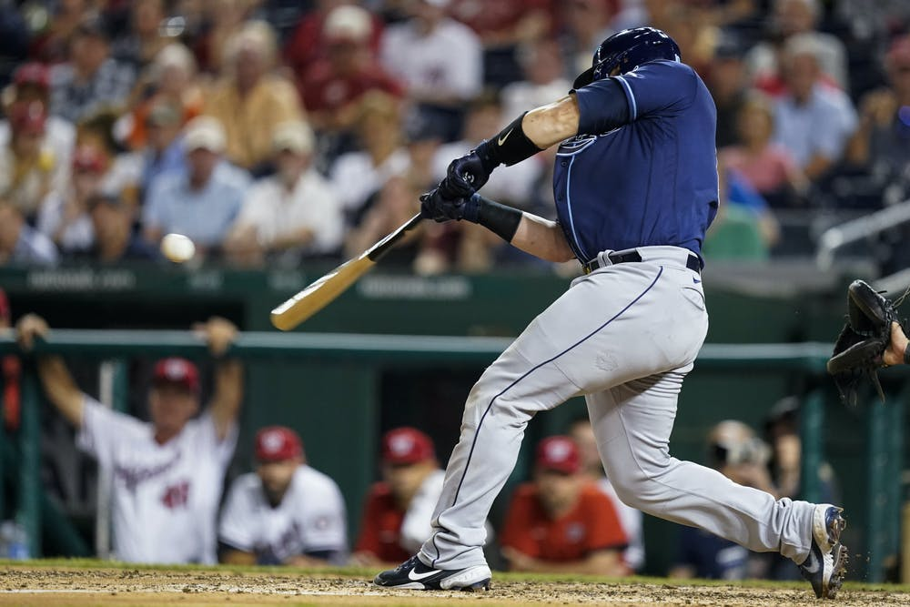 Tampa Bay Rays' Mike Zunino hits a solo home run during the ninth inning of a baseball game against the Washington Nationals at Nationals Park, Tuesday, June 29, 2021, in Washington. (AP Photo/Alex Brandon)