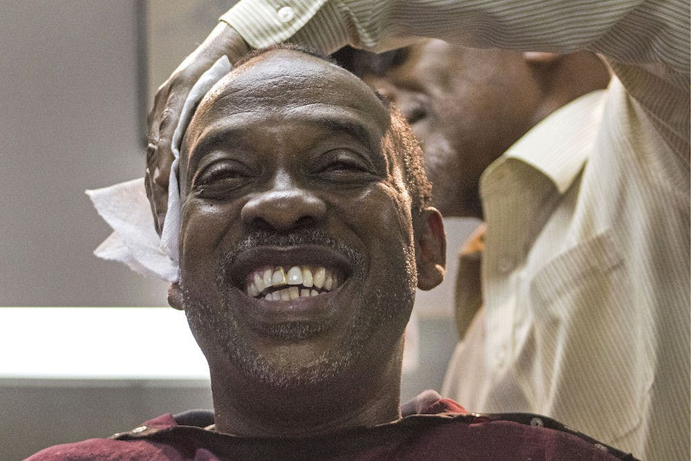 """<p dir=""""ltr""""><span>Vincent Tate, 51, receives a haircut Tuesday from Edward Young, 64, at the Clean Cut Barber Shop on Northwest Fifth Avenue. Tate moved from Alabama to Gainesville for a fresh start, and he has worked for the Alachua County School Board for 25 years.</span></p>"""