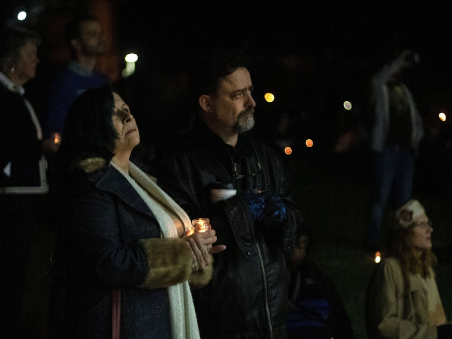 Carmen King, 55, and Christopher King, 58, stand in solidarity Wednesday evening as the names of transgender people who have lost their lives to transphobic violence are read aloud during the Transgender Day of Remembrance at Depot Park. The King's said they have a transgender daughter who lives in Holland.