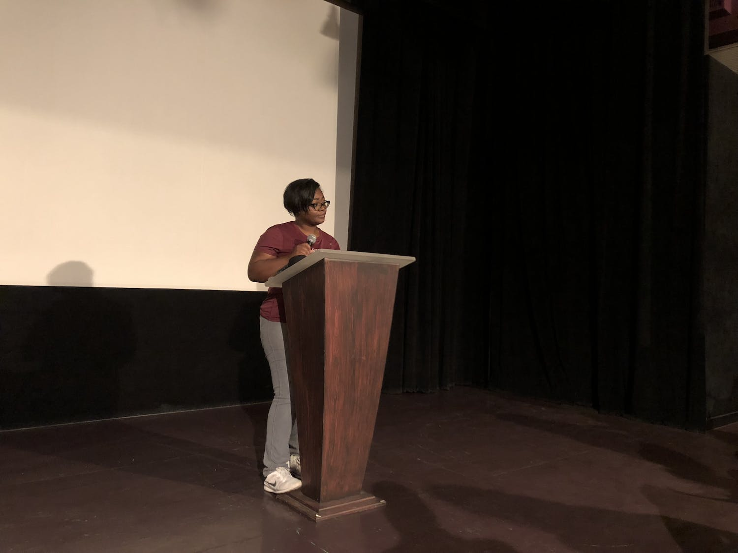 Chanae Jackson-Baker is speaking to a crowd of about 70 people at the Hippodrome Theatre on Monday evening about the inequity in Alachua County schools.