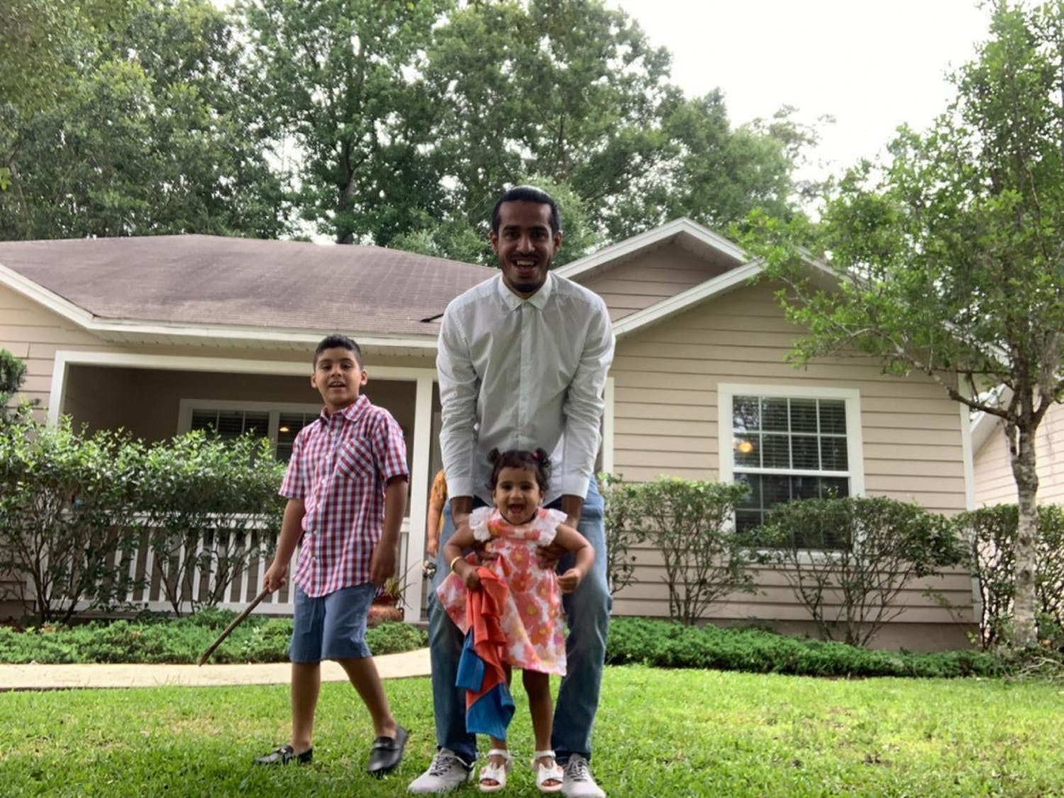 Nawaf Alrogiaee celebrates Eid al-Fitr from his family's Gainesville home alongside his two children, Ammar, 7, and Alia, 1.