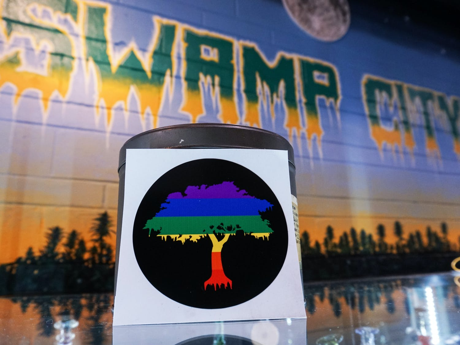 A Pride Tree sticker at Swamp City Gallery Lounge on Sunday, June 13, 2021. Swamp City is running a pride month campaign, where patrons can take a photo of pride tree stickers placed in different locations for a chance to win $300 worth of accessories and products.