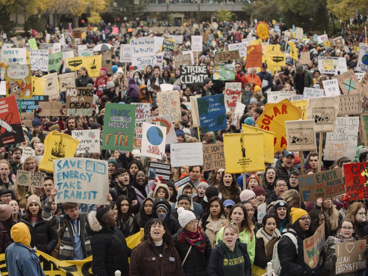 Marchers gather for the Climate Strike in Edmonton, Alberta, on Friday, Sept. 27, 2019. (Amber Bracken/The Canadian Press via AP)