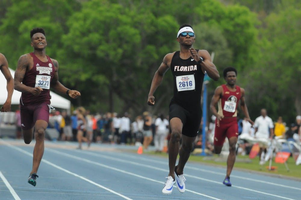 <p><span>Kunle Fasasi races in the 400-meter dash during the Florida Relays on April 1, 2016, at the Percy Beard Track.</span></p>