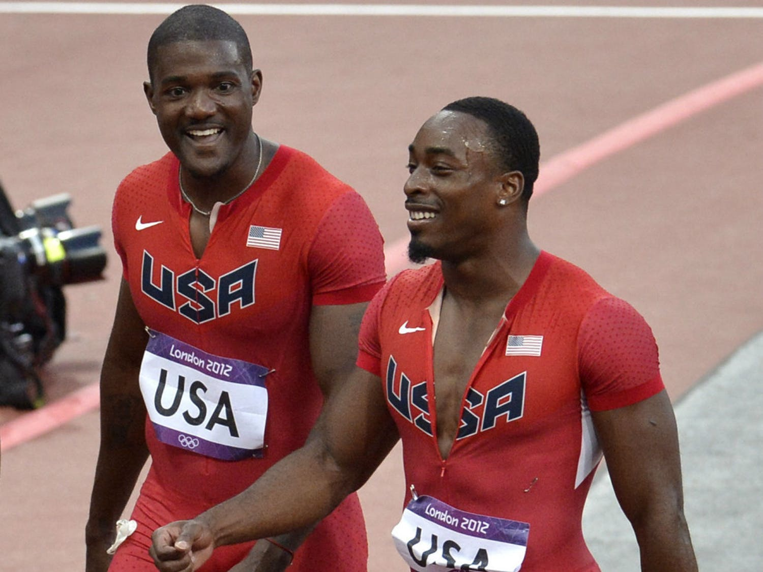 Jeff Demps (right) smiles during the 2012 Summer Olympics in London, England.