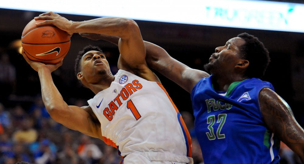 <p>Florida forward Devin Robinson fights for a shot against Florida Gulf Coast forward Antravious Simmons during the first half of an NCAA college basketball game, Friday Nov. 11, 2016, in Jacksonville, Fla. (Bob Mack/The Florida Times-Union via AP)</p>