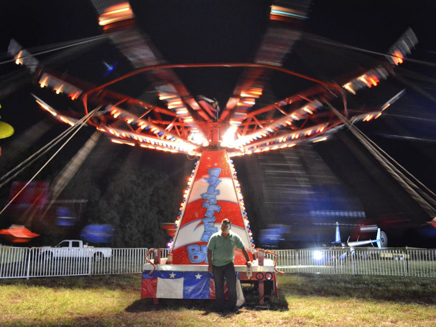 David Bocarando, a 22-year-old Big O Amusements employee, runs the Jitterbug ride at the Ohana Candy Cane Festival on Nov. 21, 2015. All profits from the festival went towards 100 Thanksgiving dinners for families in need.