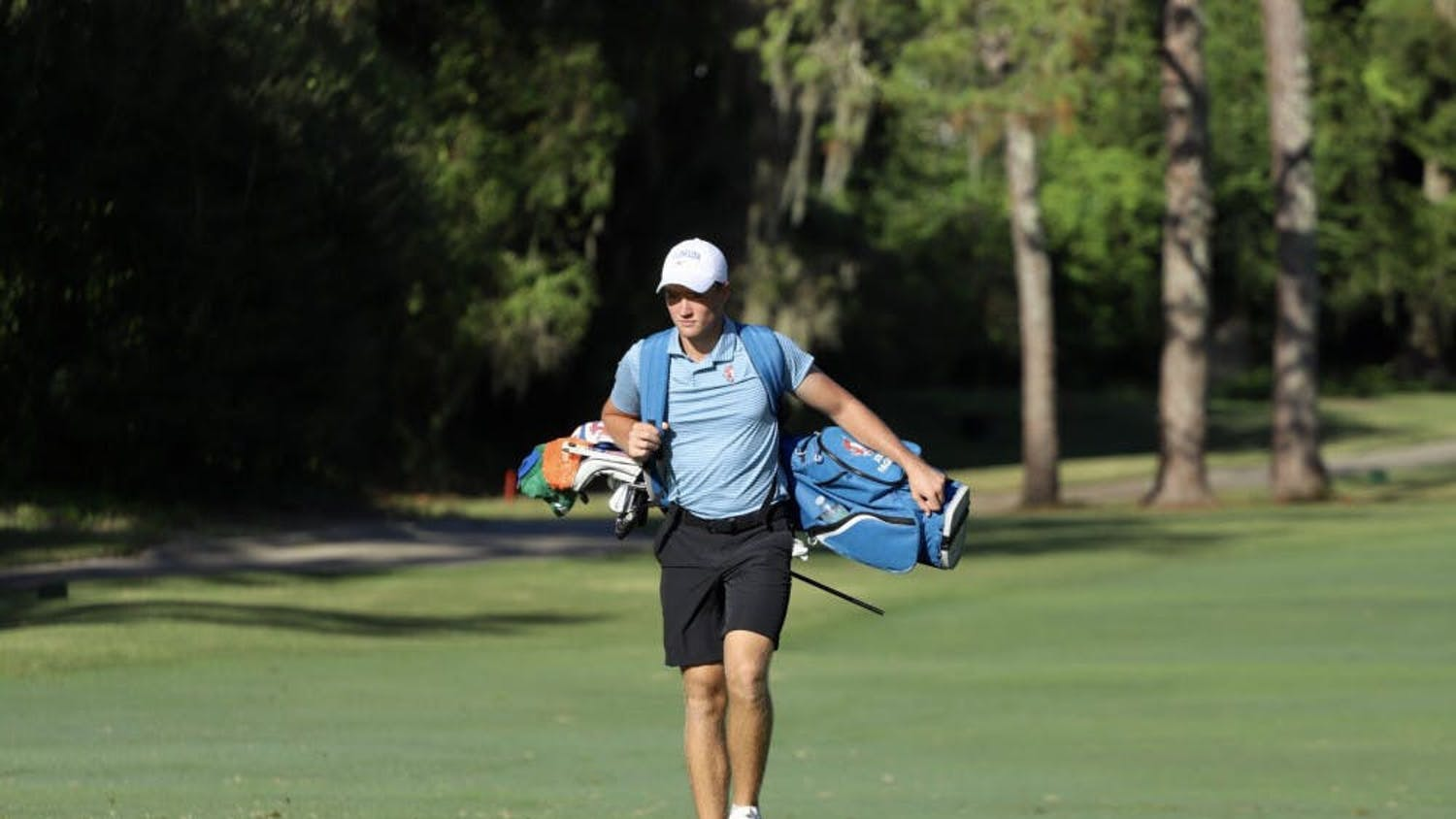 Florida's Joe Pagdin walks the fairways of Mark Bostick Golf Course in Gainesville, Florida. Pagdin shot 79 Saturday as the Gators slipped down to a tie for 22nd in the national championship.