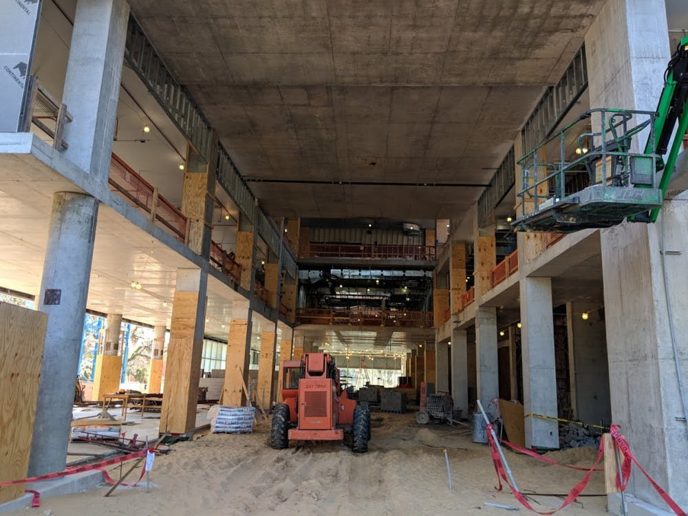 """<p><span>The construction of the Herbert Wertheim Laboratory for Engineering Excellence is projected to cost more than $70 million, which is $20 million more than its projected cost. The building is located between the Reitz Union and Weimer Hall, and it will house study rooms and labs.</span></p><div class=""""yj6qo ajU""""></div>"""