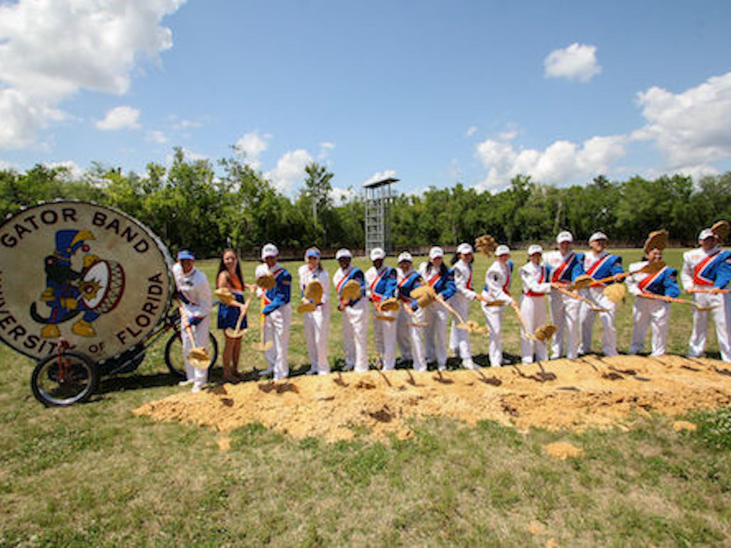Gator Band members toss dirt to break ground for the new Gator Marching Practice Facility on April 13.