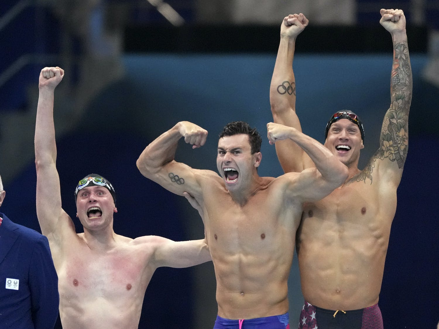 United States men's 4x100m freestyle relay team of Bowen Beck, Blake Pieroni, and Caeleb Dressel react after winning the gold medal at the 2020 Summer Olympics, Monday, July 26, 2021, in Tokyo, Japan. (AP Photo/Matthias Schrader)