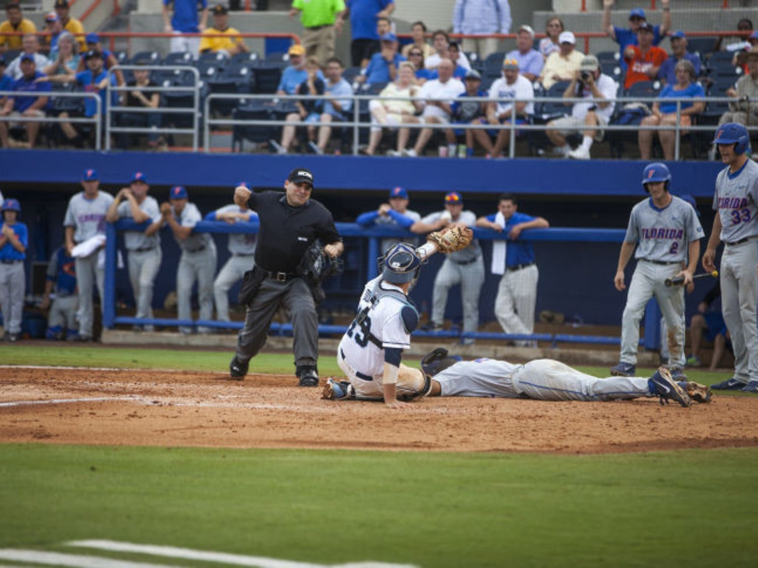 UF shortstop Richie Martin is tagged out at home plate by UNC catcher Korey Dunbar during Florida's 5-2 loss on Saturday at McKethan Stadium. The loss eliminated the Gators from the NCAA Tournament.
