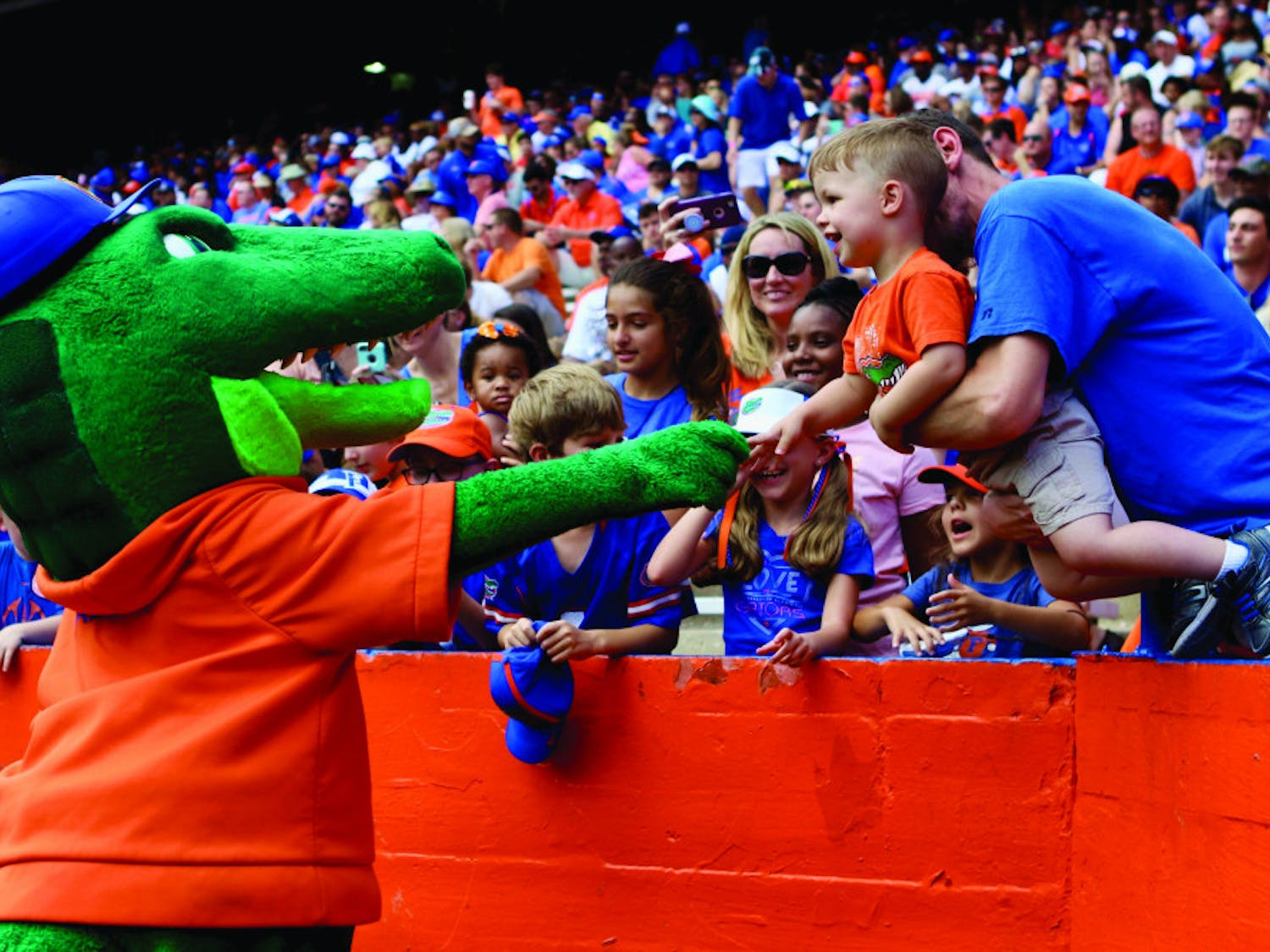 Albert E. Gator greets a young Gator fan during the Orange & Blue football game in January 2019. The scrimmage held at Ben Hill Griffin Stadium had 53,015 in attendance.