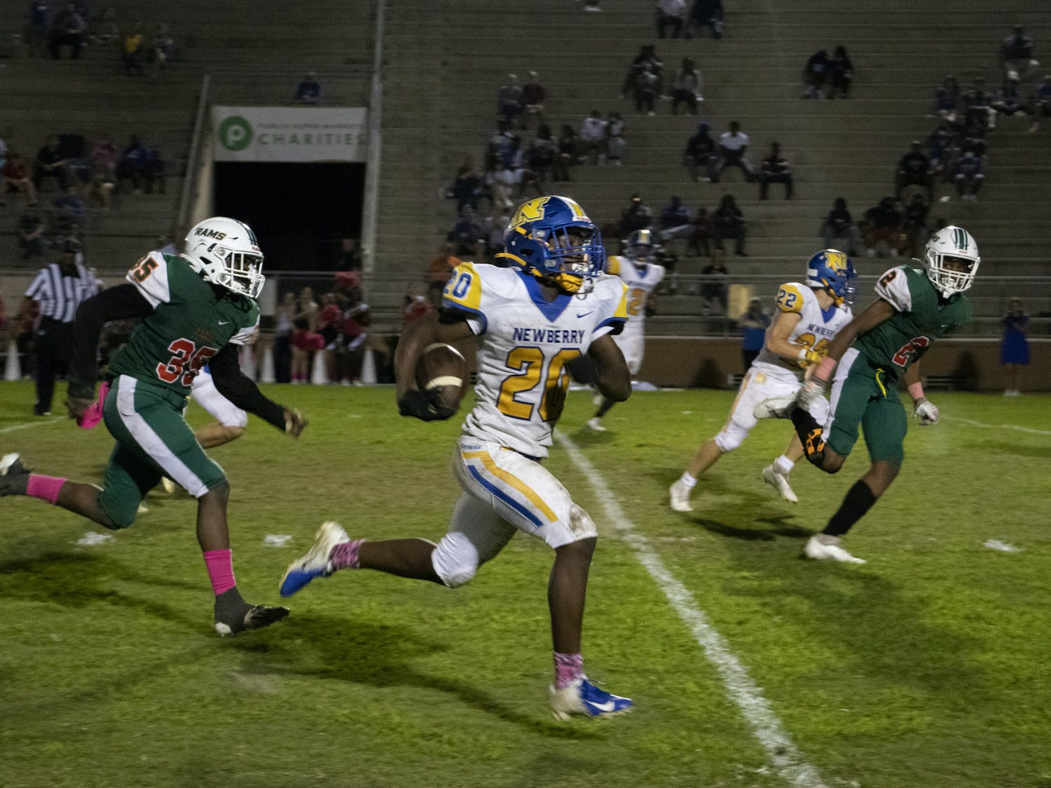 Keenon Johnson (middle), Newberry Panthers running back, runs the ball down Citizens Field during a game against the Eastside Rams on Thursday, Oct. 14, 2021.