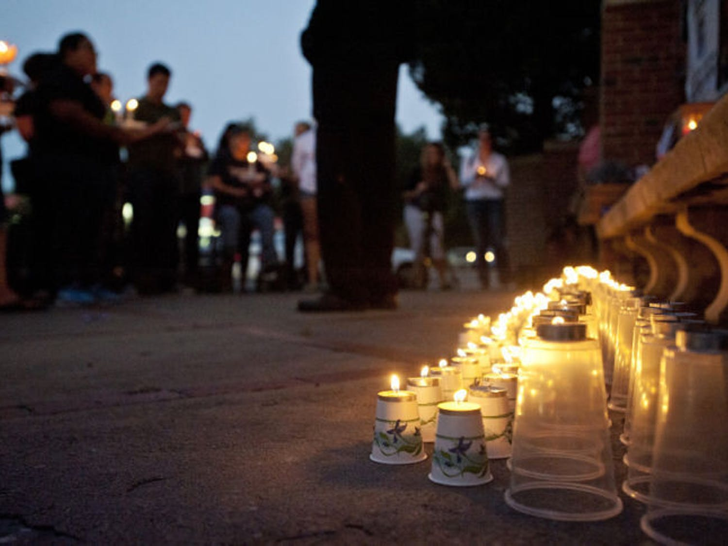 The Reverend William H. Russell Jr., 51, from The United New Testament Church International speaks at a candlelight vigil held for missing Christian Aguilar on the corner of Southwest 13th Street and West University Avenue Thursday evening. Christian Aguilar went missing on Sept. 20, Pedro Bravo, the main suspect in the disappearance was indicted with murder and kidnapping charges on Monday.