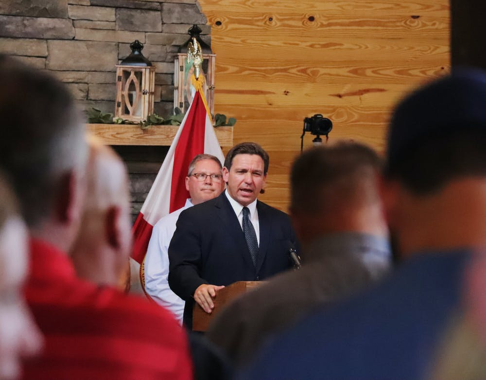 Gov. Ron DeSantis speaks to a crowd of over 200 involved in a lawsuit filed against the City of Gainesville for mandating vaccines for city employees at Clark Plantation Wedding Venue in Newberry, Florida, on Monday, Sept. 13, 2021.