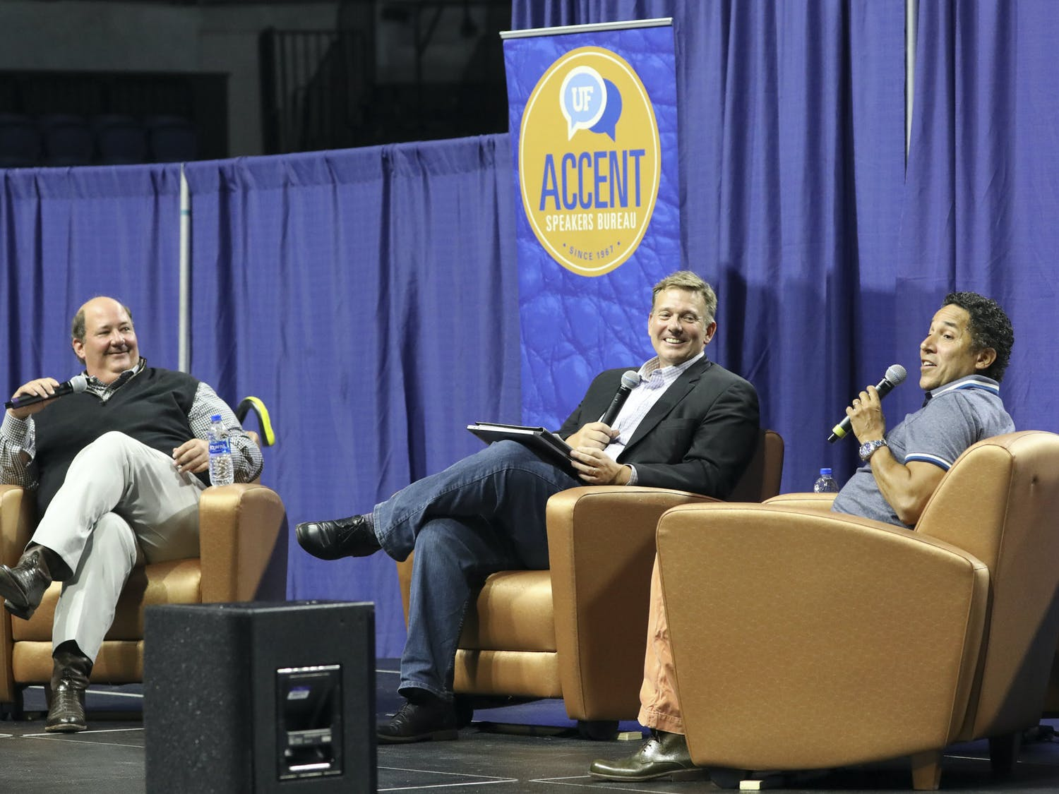 UF journalism professor Ted Spiker (center) moderates a conversation with ACCENT Speakers Bureau guests Brian Baumgartner (left) and Oscar Nuñez (right) on Wednesday, June 30, 2021. The event is the first fully in-person Accent event since October 10, 2019, before the COVID-19 pandemic.