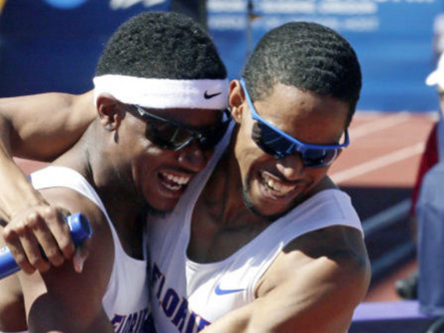 Hugh Graham Jr. (left) hugs Arman Hall after winning the 4x400m relay during the NCAA Outdoor Championships in Eugene, Ore., on Jun. 8, 2013.