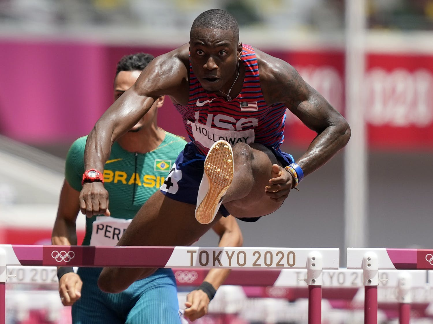 Grant Holloway, of United States competes in a men's 110-meter hurdles semifinal at the 2020 Summer Olympics, Wednesday, Aug. 4, 2021, in Tokyo, Japan. (AP Photo/Martin Meissner)