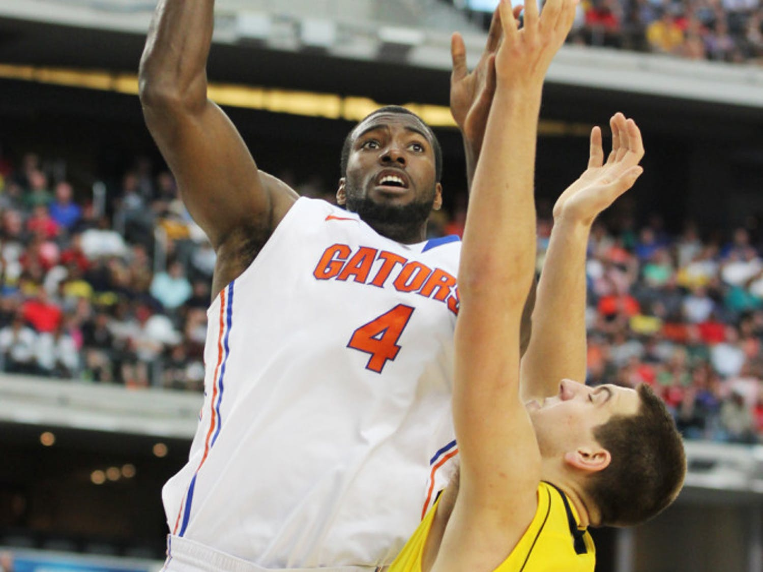 Center Patric Young attempts a shot during Florida's 79-59 Elite Eight loss to Michigan on March 31 in Arlington, Texas.