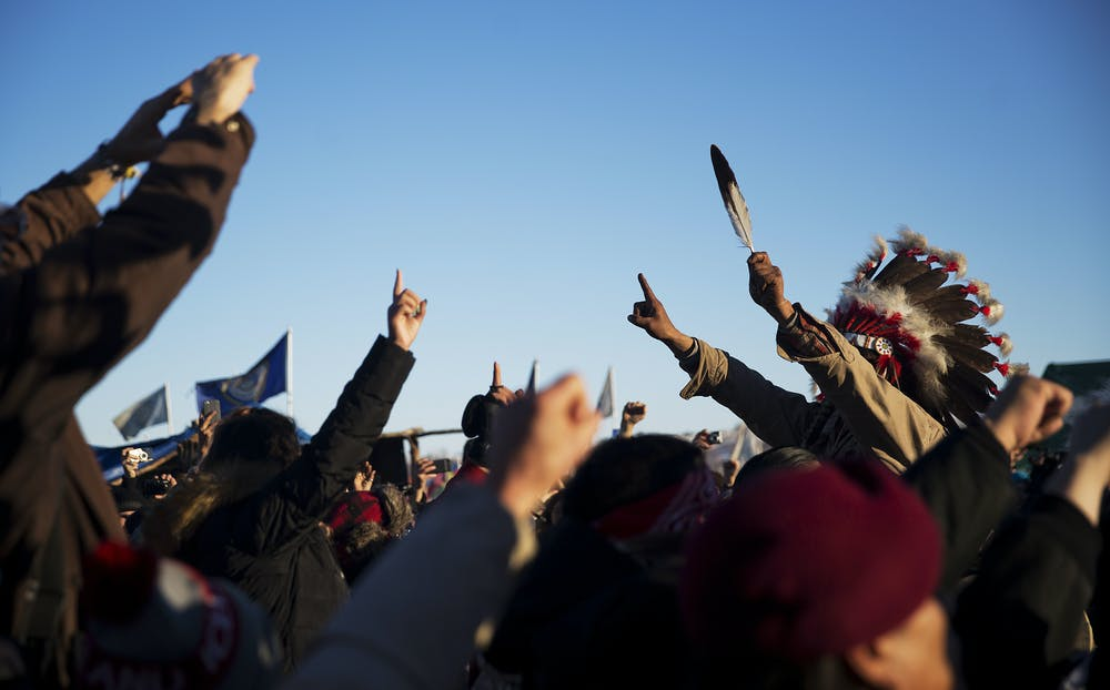 <p>A crowd gathers in celebration at the Oceti Sakowin camp after it was announced that the U.S. Army Corps of Engineers won't grant easement for the Dakota Access oil pipeline in Cannon Ball, N.D., Sunday, Dec. 4, 2016.</p>