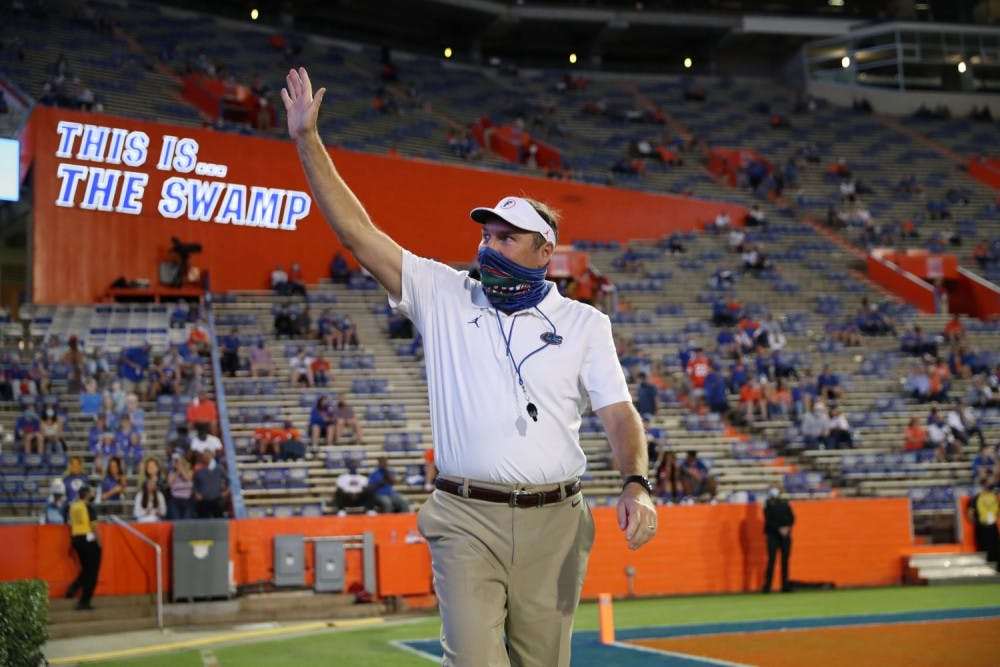 <p>Gators Coach Dan Mullen greets fans prior to Florida's home game against Mizzou Oct. 31. UF beat the Georgia Bulldogs for the first time with Mullen at the helm on Saturday.</p>
