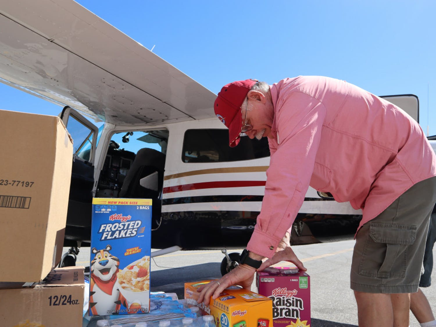 Pilot Mark Creighton, of Port Aransas, Texas, loads nonperishable food onto a plane headed to Appalachia, Florida, for Operation Airdrop. His home flooded during Hurricane Harvey, and he's helped other victims of hurricanes through Operation Airdrop since.