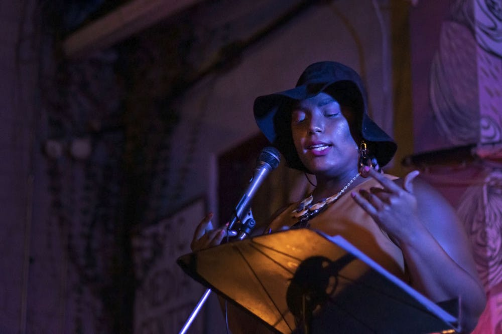 <p>Kayla Rodney performs at the open mic night Sept. 24 at the Civic Media Center. Rodney was the featured artist for the night, which had a theme of Afrofuturism, a genre of media that blends black culture with science fiction and technology.</p>
